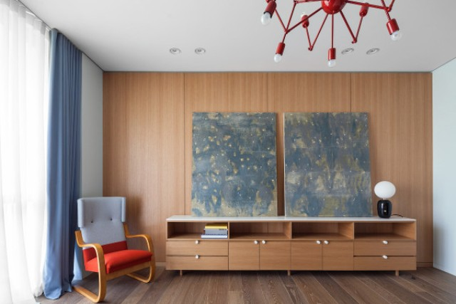 This is a mid-century modern room with soothing art pieces