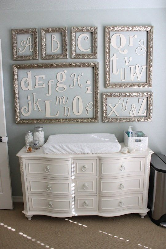elegant changing station with framed letters art