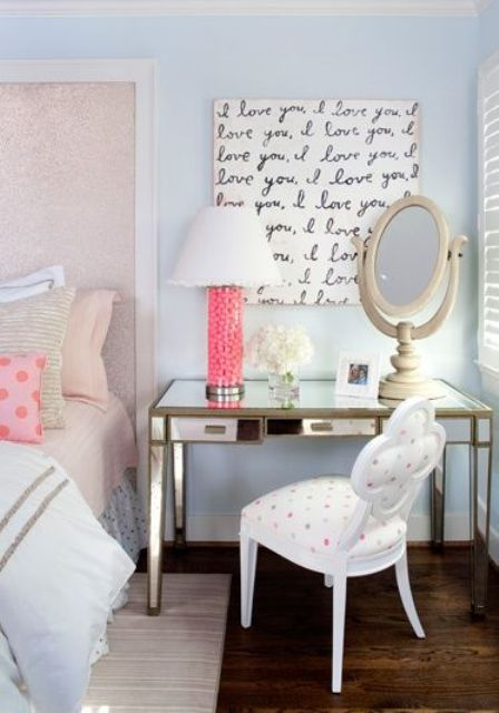 glam bedroom with a gilded desk next to the bed