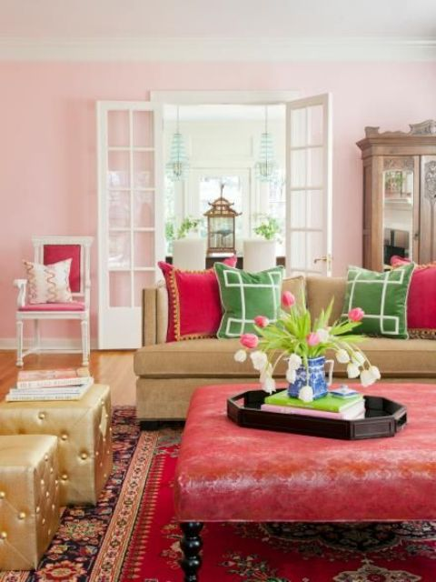 15 Pink, fuchsia, red and green are grounded by the honeyed tones of hardwoods and a caramel sofa