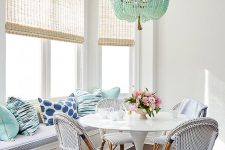 15 seaside blue and aqua breakfast area with bamboo chairs