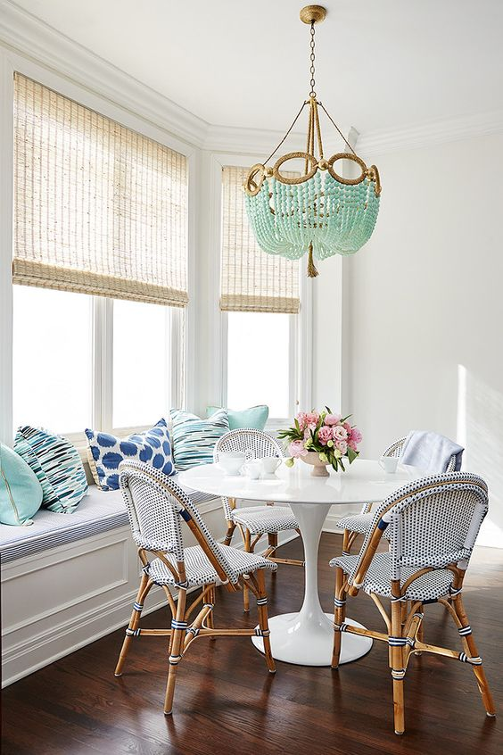seaside blue and aqua breakfast area with bamboo chairs