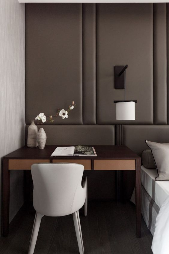 refined modern bedorom with a desk nook by the bed