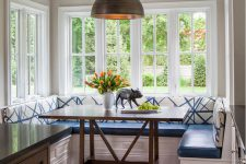 16 blue and white breakfast zone with a dark table and a dark pendant light fixture
