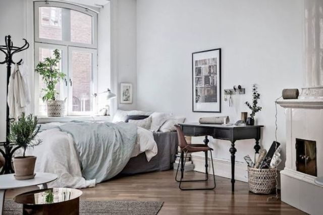 Scandinavian Bedroom With A Black Desk By The Fireplace