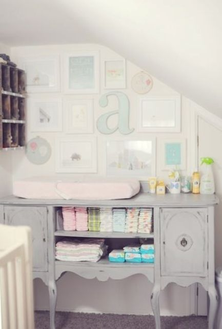 grey shabby chic changing station with a gallery wall