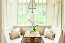 18 cozy rustic breakfast nook with a rough wood table and three benches that surround it