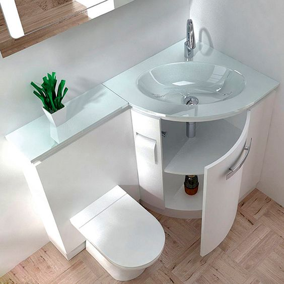 Unique a sink with a storage space and counter and a toilet in one unit