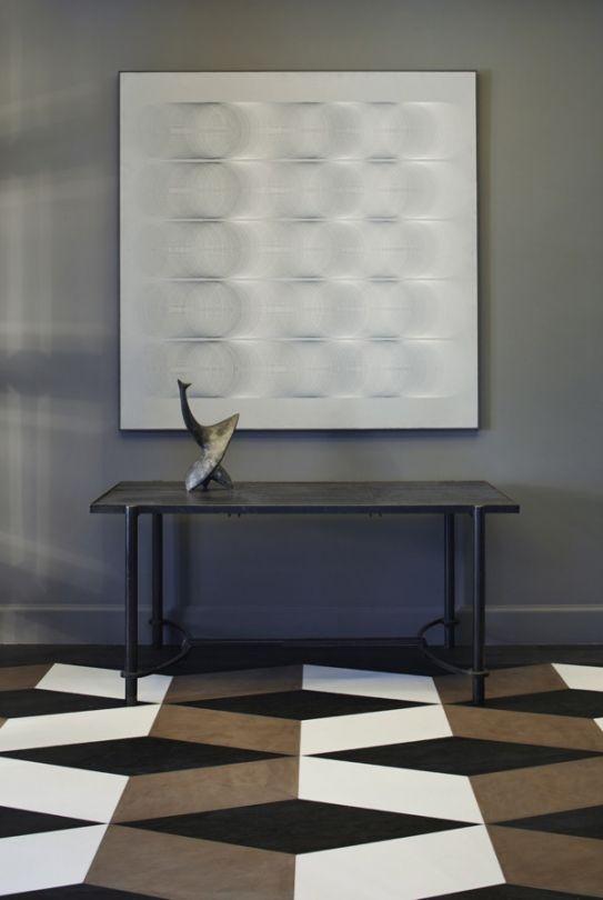 the artwork alongside those bold floor tiles, plays tricks on the eyes.