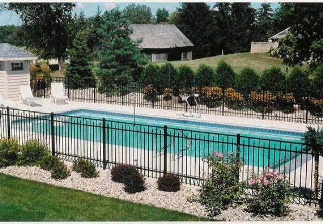 30 stylish and practical pool fence designs digsdigs for Garden designs around pools