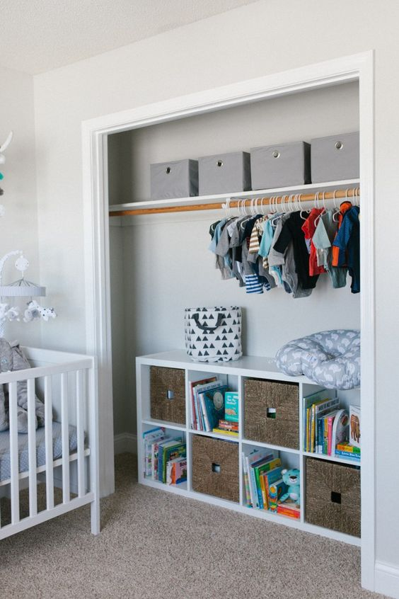 open closet with cubbies and drawers for toy storage