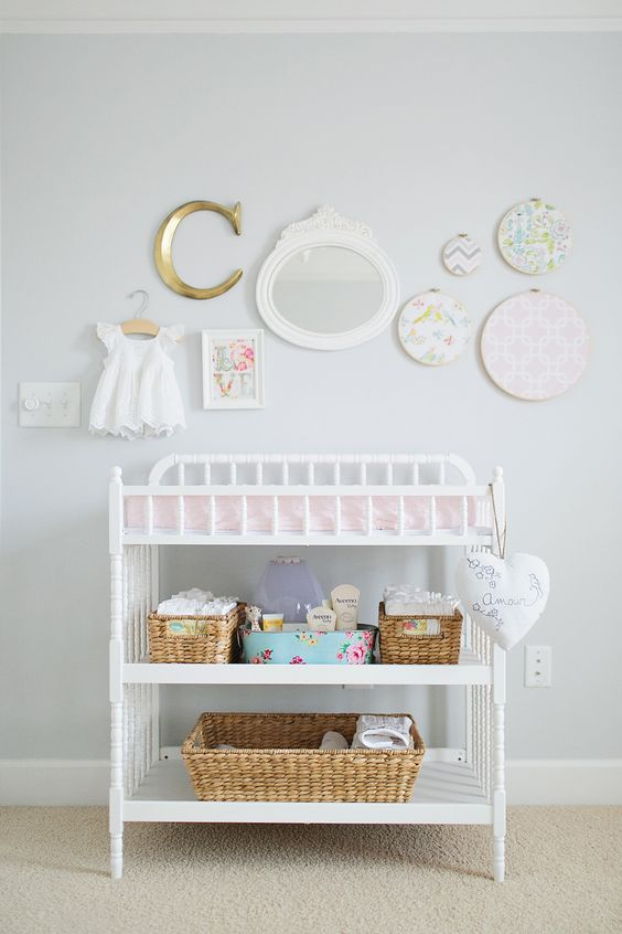simple white changing table with cubbies for storage
