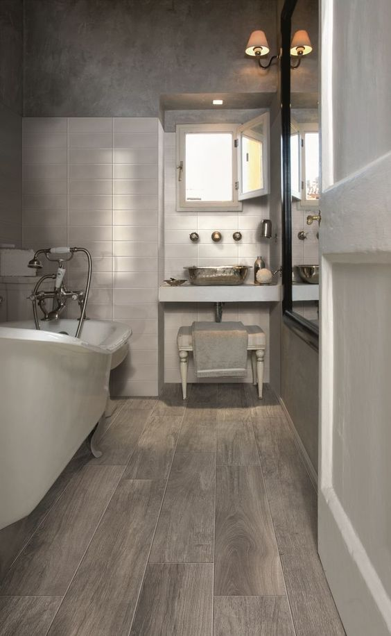 such wood-look floor tiles are perfect for a bathroom where it's often humid