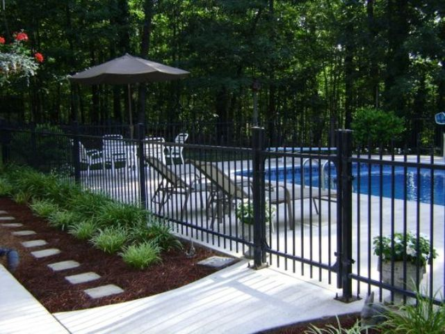 30 stylish and practical pool fence designs digsdigs for In ground pool fence ideas