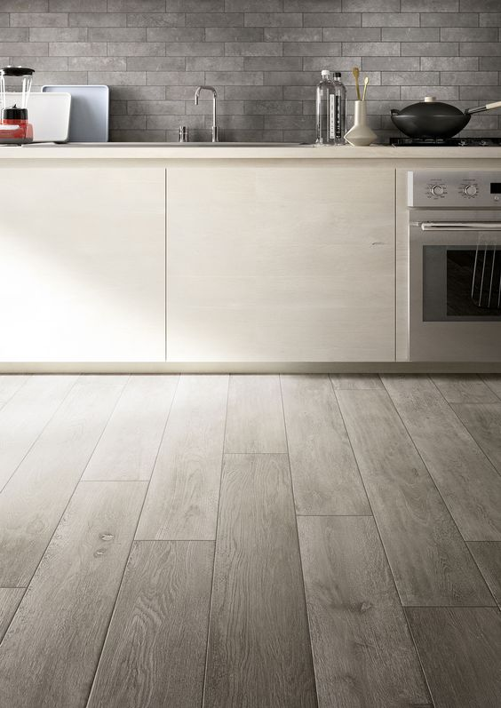 ceramic wood-printed grey tiles work great in every kitchen where floors may be scratched or spoilt