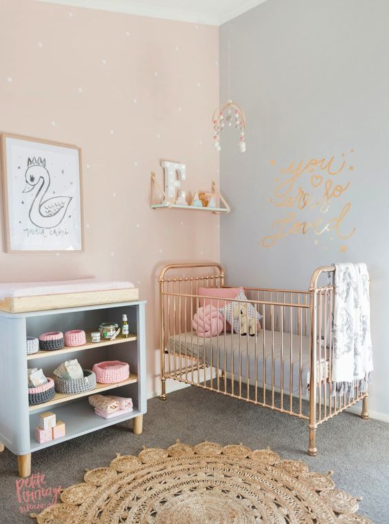 crib with a glam changing table with an open shelving
