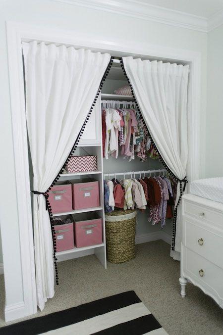 girl's nursery closet with pompom trim curtains