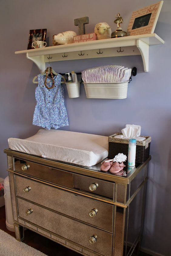 mirror changing table with a rack over it