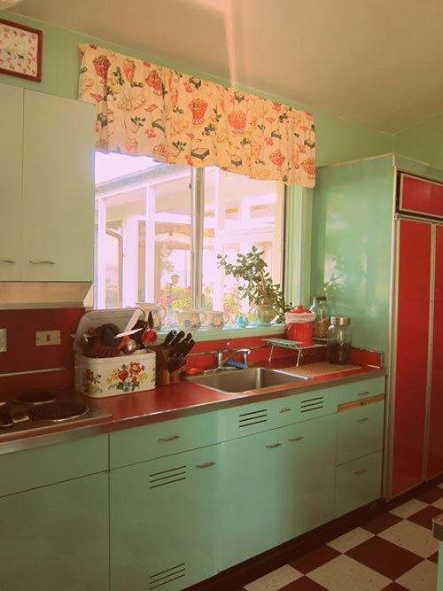 Retro mint kitchen with red countertops and appliances