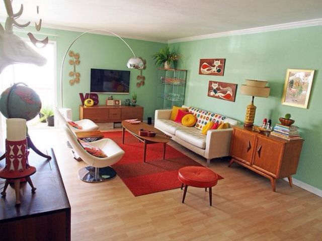 mint green walls of this mid century modern living room are balanced with a red balanced living room