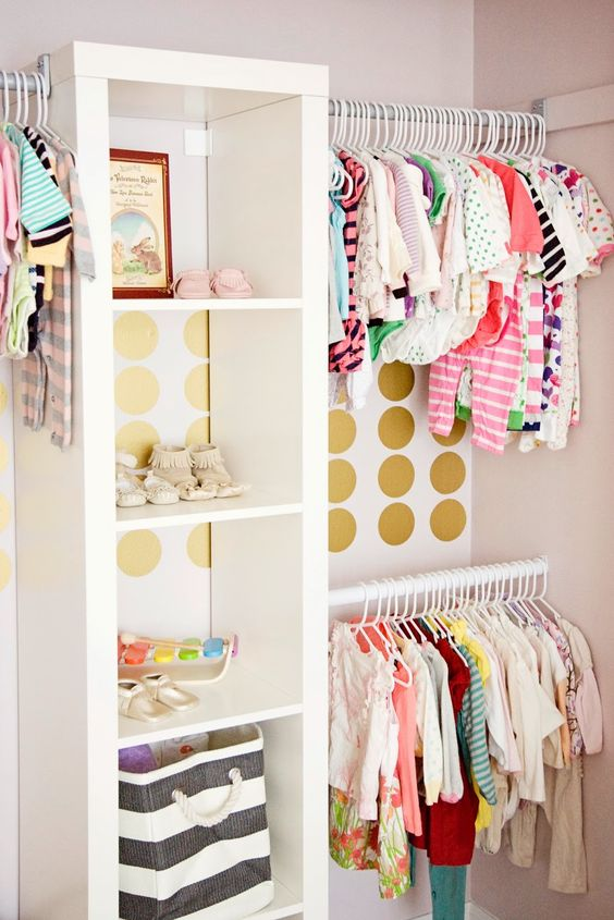 colorful glam closet with gold polka dots