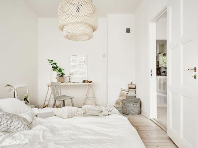 neutral bedroom with a white rustic desk