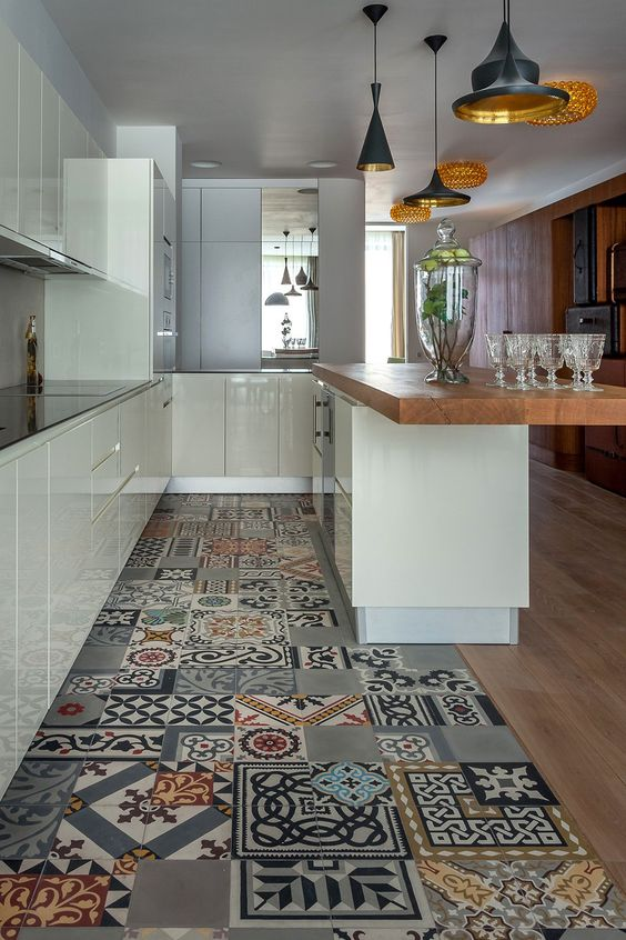 bold patterned patchwork tiles and wooden floors. beautiful ideas. Home Design Ideas
