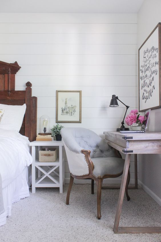 rustic bedroom with a wooden desk in the corner
