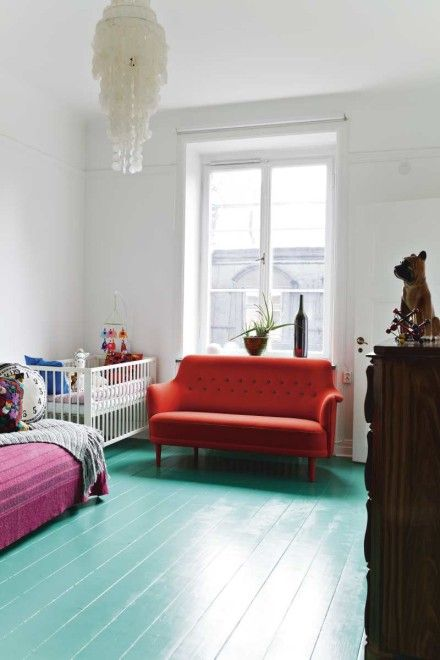 teal wooden floor in a nursery