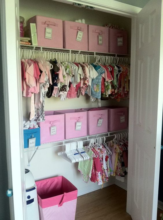 girl's closet with lots of boxes and cubbies