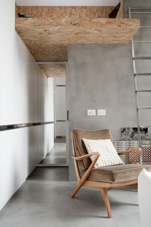 light grey polished concrete for floors and walls enlivened with warm-colored wood