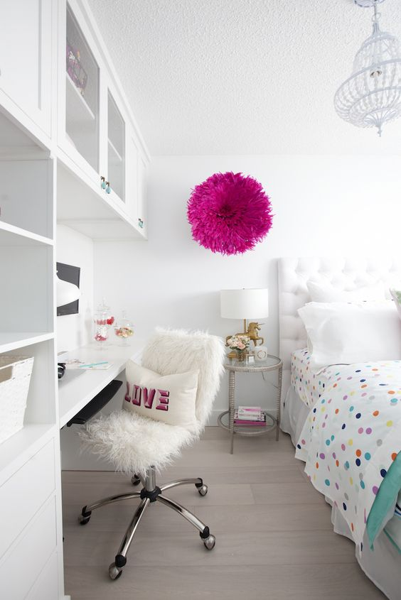 white clean room with pops of color and a desk nook