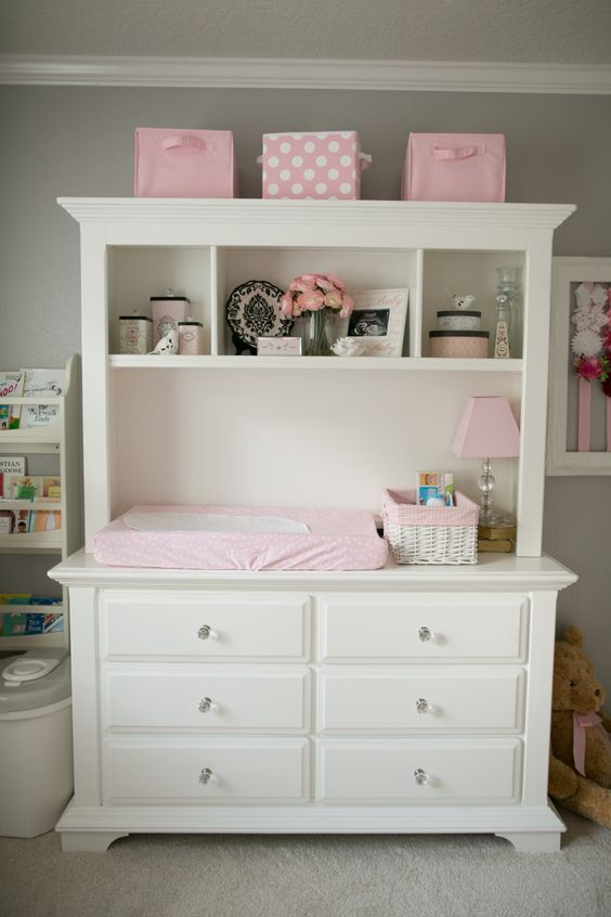 a dresser and hutch converted to a organized changing table