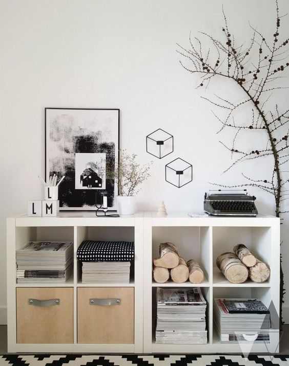 white Kallax shelving units turned into storage units with natural elements.