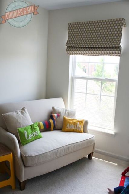 loveseat with pillows in a baby room