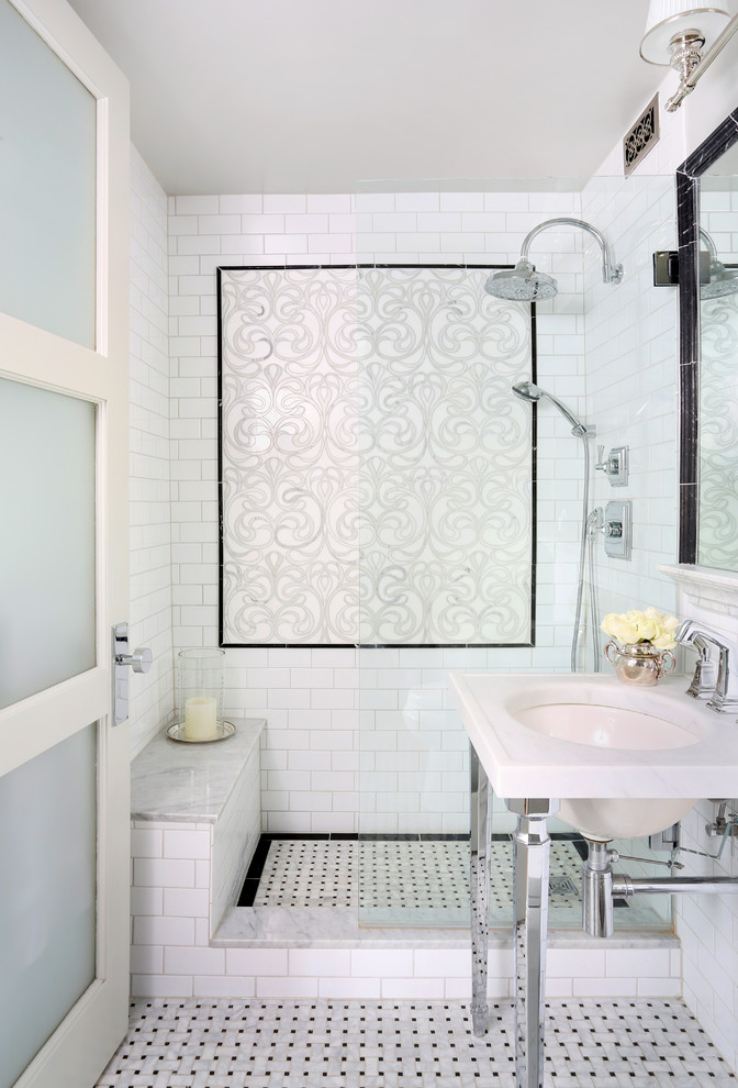 black border tiles are used as to create a tile wall art as to frame shower's flooring (Normandy Remodeling)