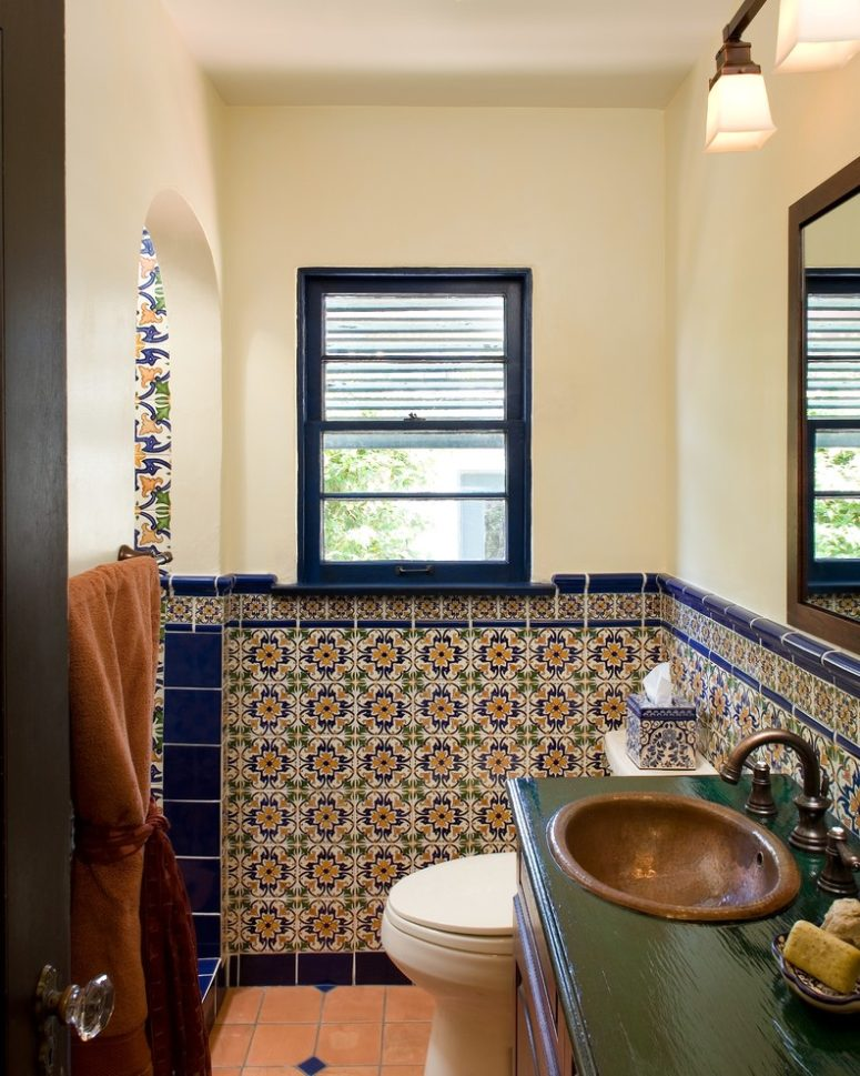 blue trim tiles separates spanish tiles from the painted parts of bathroom's walls (Avente Tile)