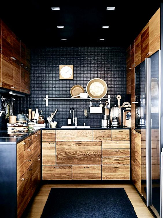 black mixes with natural light-colored wood cabinetry really well