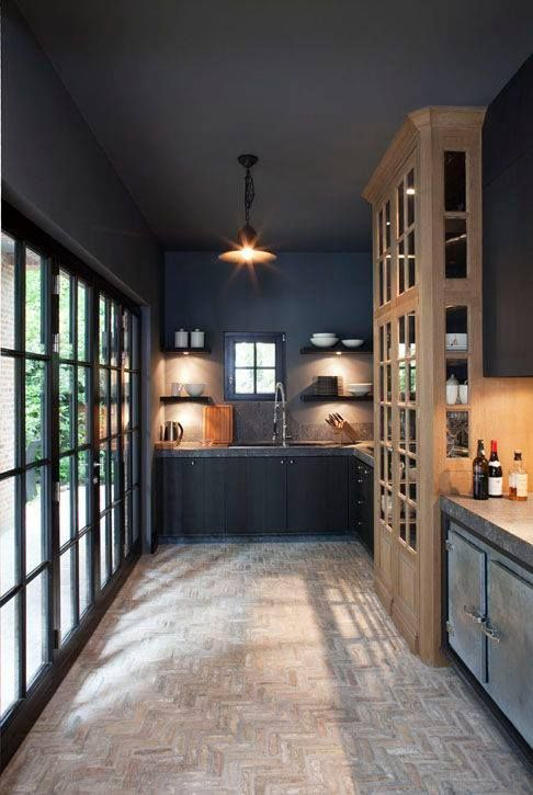 black kitchen with natural wood touches and granite countertops