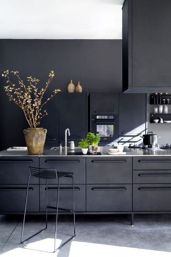 cozy industrial all-black kitchen clad with metal