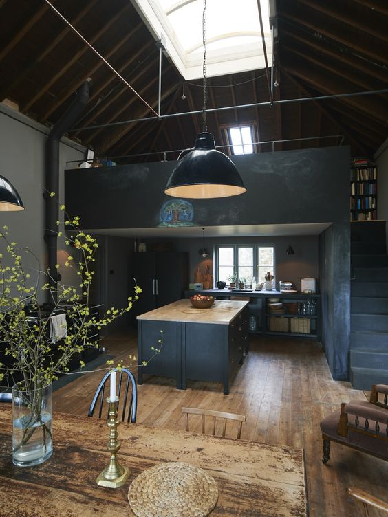 dark grey vintage-inspired kitchen with a large kitchen island