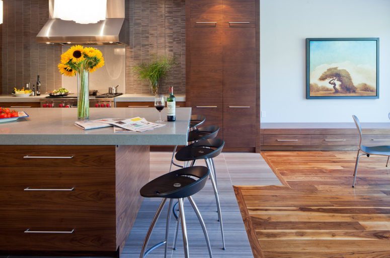 an irregular transition of natural wood flooring and kitchen floor tiles (Peter A. Sellar - Architectural Photographer)