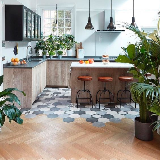 a cool wood and tile transition on a contemporary kitchen with retro elements (via @istoria_by_jordan_andrews)