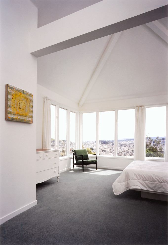gray carpet mixed with white walls is a simple solution for a modern bedroom interior (450 Architects, Inc.)