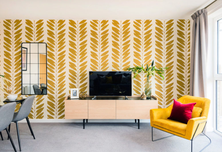 a living room with bright yellow walls and minimalist carpet flooring
