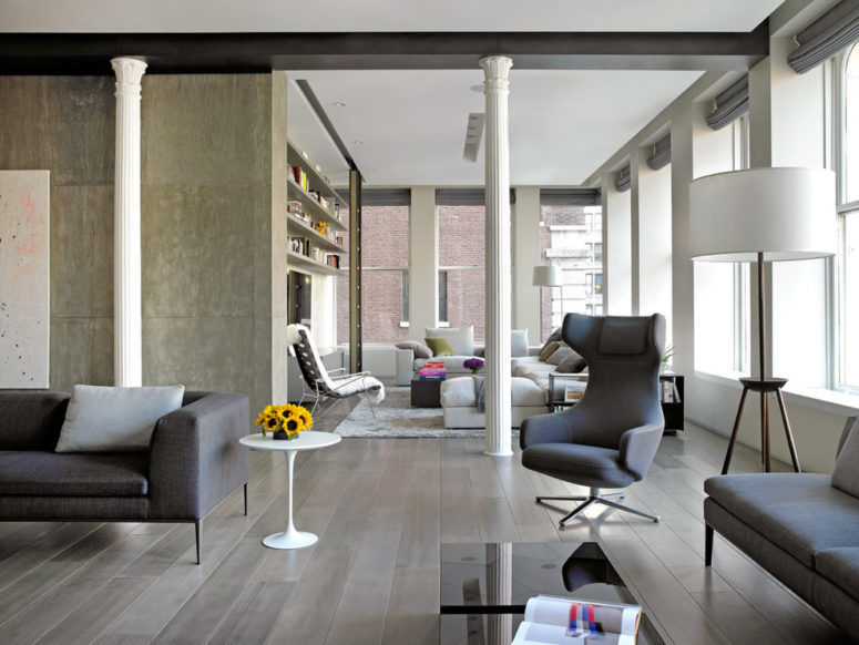 gray hardwood flooring is perfect for an open space with concrete walls (Axis Mundi)
