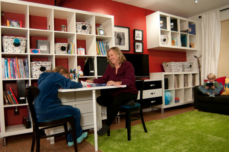 for a kids room a folding table is a quite practical solution because it can provide as space for studying as space for playing (YES Spaces, LLC)