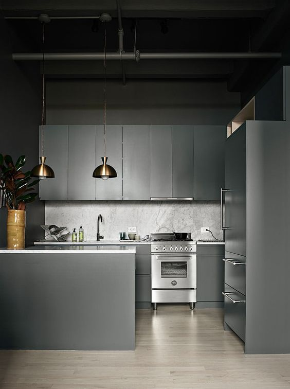moody grey design with sleek cabinets and a stone backsplash