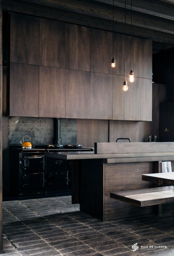 Picture of moody industrial style kitchen with timber cabinets and a black freestanding cooker - Artistic wood clad design for warm essence in your house ...