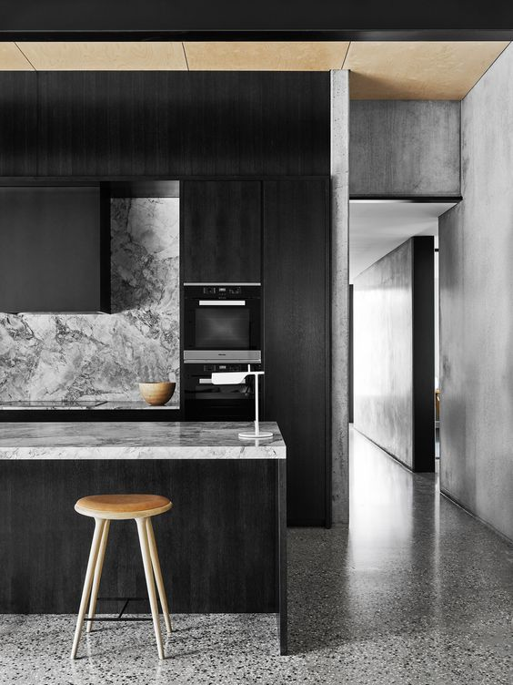 moody monochrome kitchen with veined marble surfaces